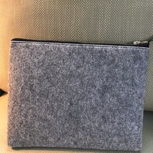Gray felt zippered clutch